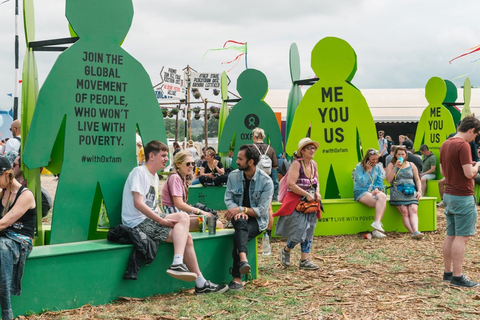 Festival goers sit down on the Oxfam 'Stand As One' seating at Glastonbury 2017.