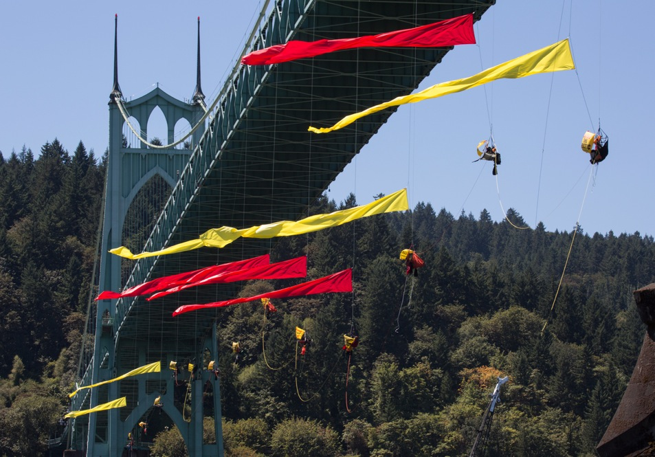 Activists hang under the St. Johns Bridge in an attempt to block the Shell leased icebreaker, MSV Fennica from passing under the bridge and joining Shell's Arctic drilling fleet. According to the latest federal permit, the Fennica must be at Shell's drill site before Shell can reapply for federal approval to drill deep enough for oil in the Chukchi Sea. People vs Shell, the climbers, are currently preventing the ship from passing underneath the bridge on its way to meet Shell's drilling fleet. The climbers have enough supplies to last for several days.