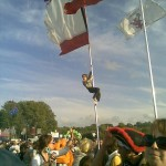 Kid climbs flagpole in Other Stage Arena.