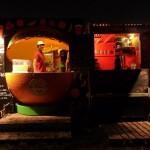 Happy smiley stallholders selling late night orange juice..
