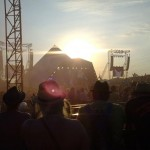 Sun setting over the Pyramid Stage as Dizzee Rascal sends the crowd 'Bonkers!'