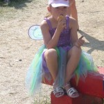 Little fairy has ice cream break.