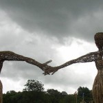 Wicker man & woman under brooding skies.