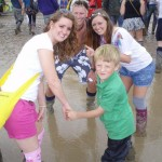 My Lad Charlie at his 1st Glastonbury being helped through the mud with Dan Carling, Rachel and Paige Armitage.