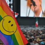 Hippy Rainbow Smile flag at the Pyramid stage during Two Door Cinema Club