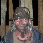 Pink beard and mud face