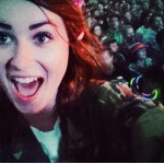 My 14 year old Lydia on her dads shoulders at Mumford and sons....Her face sums up that Glastonbury feeling