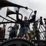 Michael Eavis enters the festival on a huge metal trailer
