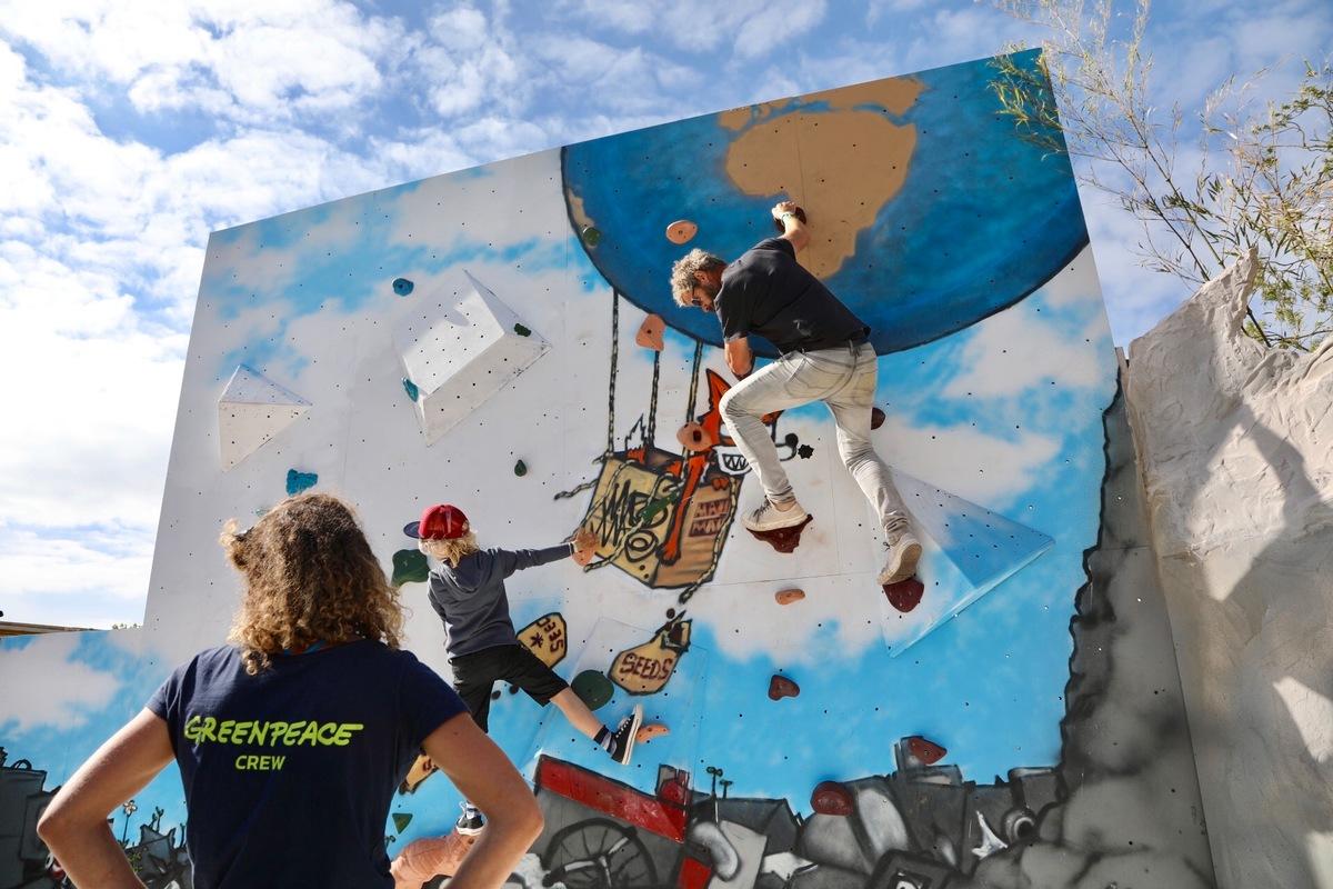 Bouldering Wall in the Greenpeace Field at Glastonbury 2017, art is created by graffiti artist Mau Mau