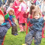 Ruairi, Tailte and Finvola on a merry-go-round in the kidz field