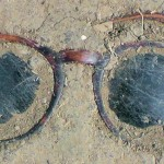 Here's looking at you - sunglasses in dried mud