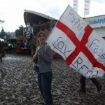 Leonie with her flag in the rain at the Pyramid field in 2007