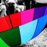 Colourful umbrella, lying around unused.