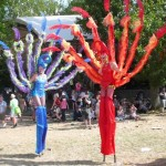 red and blue stiltwalkers
