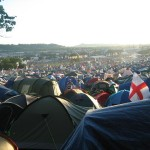 lots of tents with pyramid stage in the distance
