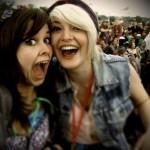 Freya and Ellie enjoying a crazy moment at Glastonbury