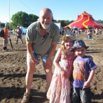 Emily (5) and Henry Rich (3) with Michael Eavis on Sunday afternoon in the circus area.
