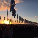 sunset behind the flags